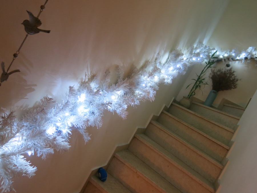 15. Take a faux tree apart, and use it as a decoration around your window frame, or by the stairs.