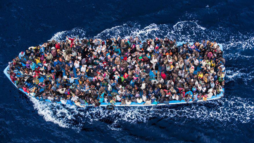 1441959186_199965_boat_migrants_risk_everything_for_a_new_life_in_europe_african_asylum_seekers_rescued_off_boats_and_taken_aboard_an_italy_navy_ship_june_8_2014